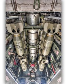 """Bombing Japan Part.2 A modern day photo, and a great view looking up into one of the bomb bays including WW2 replica 500 pound bombs, of the only B-29 still flying today, """"FIFI"""". With 40% of its fuselage dedicated to the payload, the B-29 had a maximum bomb load of 20,000lbs (9 metric tons). As many as 40 x 500 pounders could be carried. It could then haul that load - along with the 6,940 US gallons or 41,640lbs of fuel required - on the 3,000 mile round trip from the Marianas to Tokyo."""