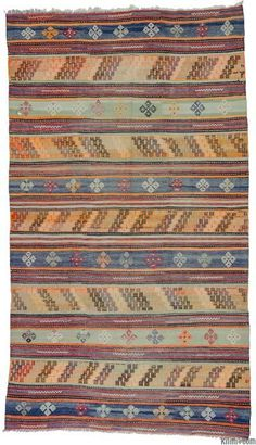 Vintage kilim rug hand-woven in Denizli, Turkey in 1970's. This striped kilim is embellished with small jijim weavings and it is in very good condition.