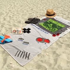 ThinkGeek BeachBoy beach towel for the retro gamer, inspired by our favorite old portable system.