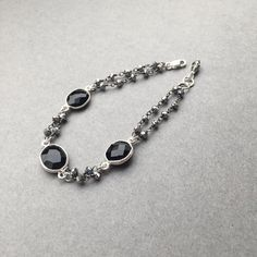 """Black+Silver; perfect arm bling for the holidays! This beauty is made up of faceted Black Spinel and dainty flashy Pyrite beads. Measures 6.75""""-7"""" ($49) #blackspinel #gemstonebracelet #gemstonejewelry"""