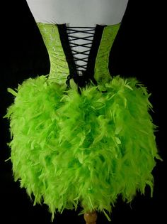 Stunning bulesque costume is made with a patterned green brocade that is boned all the way around with zip front closure front and lace up
