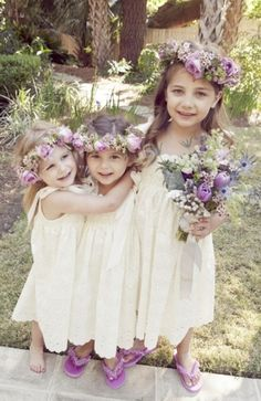 Beautiful flower girls with flower wreaths