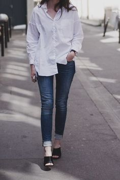 Mules look chic with skinny jeans and a button down shirt.