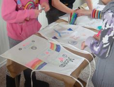 Art Party... as guests arrived, they used fabric markers to design their aprons/smocks.