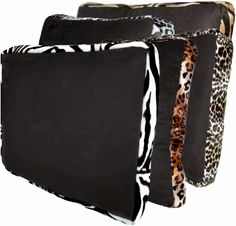 Zebra Animals Bordering Africa Pillow  Exotic Elegant Look! Plush Ebony Faux Suede, trimmed in Faux Fur Animal Print. Incredible alone, or in pairs.  Poly fiber Pillow, with a none-removable Cover. Damp Cloth Cleaning Recommended.   Available in Square,Rectangle,Triangle, and Round.  $59.00