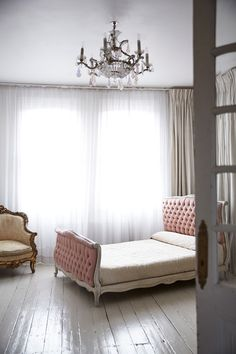 charming antique pieces make this beautiful room* tufted bed* chair* chandelier* french doors* lovely