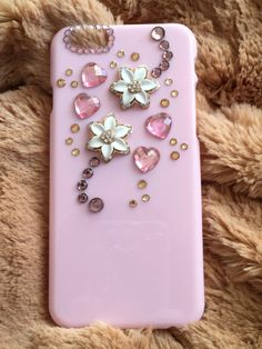 Pretty pink case for iphone 6, decorated with pink hearts and rhinestones metallic white flowers.  Every case we do we do it with much care
