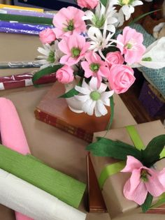 crepe paper into the shapes of beautiful flowers.