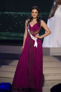 Zhaneta Byberi, Miss Albania 2014 competes on stage in her evening gown during the Miss Universe Preliminary Show in Miami, Florida on January 21, 2015.