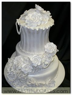 white rose wedding cake with pearls