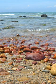 Gorgeous red-colored rocks on one of the beaches. | Martha's Vineyard {family holiday}