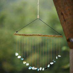This rustic DIY Sea Glass Wind Chime Suncatcher is a unique .This rustic wind chime made of sea glass for do-it-yourselfers is a unique outdoor decoration that you can attach on the terrace, in the Sea Glass Crafts, Sea Glass Art, Stained Glass Art, Sea Glass Jewelry, Silver Jewelry, Glass Beads, Wire Jewelry, Diamond Jewelry, Glass Vase