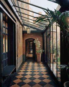 Orangery...or maybe leading out into the garden. Not a conservatory but something to bring the outside in