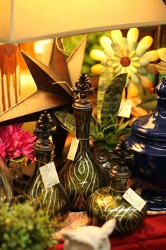 pretty decorative  apothecaries in dark olive greens with design  Want to see more items (at affordable prices)?  Like us on Facebook, too.  Our photo will take you there.