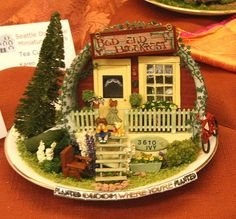 Ivy Bed and Breakfast quarter scale front porch scene in a teacup by Rosemary Shipman.