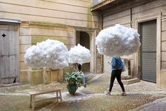 Head in the Clouds Installation in South of France French creatives Mickaël Martins Afonso and Caroline Escaffre-Faure worked together for a poetical installation for Festival des Architectures Vives happening in Montpellier. They created little clouds sculptures Head in the Clouds in a courtyard where visitors get lost and see their heads turned into cumulus through an effect of perspective and angle. Photos by by Paul Kozlowski photoarchitecture.com #xemtvhay