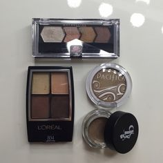 Drugstore Eyeshadow Set Set of 4 drugstore brand eyeshadow products. Loreal eyeshadow quad #804 Autumn Leaves, Maybelline eyeshadow quad #70 Copper Chic, Pacifica single shadow in Treasure, and Be A Bombshell cream eyeshadow base in Submissive. Makeup Eyeshadow