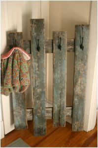Recycled old wood made into a rack to hang dress up clothes, hot pad, broom and dustpan etc. in dramatic play area or buckets with crayons, markers, colored pencils etc. in art exploration center