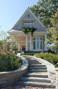 The curving staircase, the bowed French windows and the porch columns all contribute to the immense curb appeal of this home.