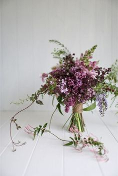 lilacs, greens, and lavender wedding bouquet
