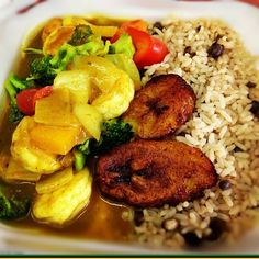 Jamaican food..Curry Shrimp, peas and rice and plantians..