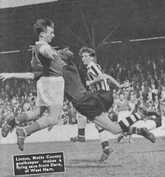 3rd September 1955. Notts County goalkeeper Jimmy Linton saves from West Ham United centre forward Billy Dare who makes a desperate dive for the ball, at Upton Park.