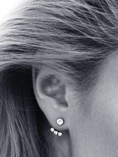 "A modern way to wear classic diamond and pearl studs is with ""below the ear"" attachments by French jewelry designer Yvonne Léon. The look is still simple and elegant but with an unusual, striking t..."