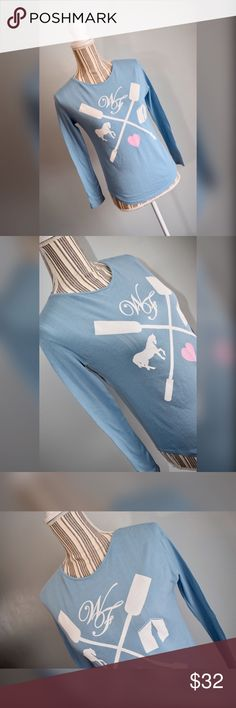 """🎀Wildfox Kids Tee🎀 Blue long-sleeved tee with oars, horses, and a heart by Wildfox Kids. Size 14. New with tags.   Material: 100% Cotton  Measurements  Bust: 34"""" lying flat, stretches to 38""""  Shoulder to Hem Length: 22""""  Sleeve Length: 19.5"""" Wildfox Shirts & Tops Tees - Long Sleeve"""