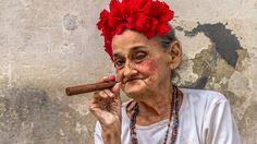 Cuba woman cigar -- — A woman poses with a cigar on a street in Old Havana… Female Poses, Female Portrait, Cigar Quotes, Old Havana Cuba, Maiden Mother Crone, Salsa Party, Cuban Party, Havanna, Havana Nights