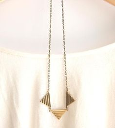 Cute necklace on a longer chain. There are 4 options for lengths. Geometric Brass Triangle Necklace by Peachtreelane on Scoutmob Shoppe