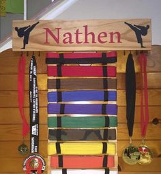 Martial arts belt display by SportsVault4athletes on Etsy https://www.etsy.com/listing/239368151/martial-arts-belt-display