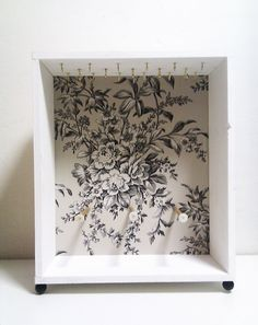 Wall Mount or Free Standing White Flower Jewelry Cabinet by Ayliss-Bigger shadow box with single row of hooks with wallpaper in the back!!