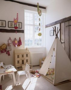 Tent in playroom as reading corner.