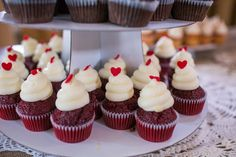 So sweet! Heart-topped Southern Red Velvet mini cupcakes at Erin & Wesley's beautiful wedding | Photo credit Molly Joseph Photography #weddingcupcakes #charleston #cupcakedownsouth