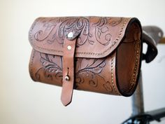 The Seeker - Hand tooled, Hand Sewn Veg Tan Leather Saddle Pouch. $150.00, via Etsy.