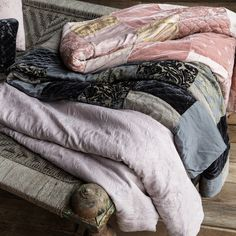 "Bella Notte offers luxurious, eco-friendly linens and decor in custom-dyed colors and irresistible textures. The artistic Sophia throw blanket highlights a tonal medley of jacquards and velvets for an exquisite bedroom accent. Available in several rich shades, this soft throw is lightly padded and backed in satin. Each order is custom made in the USA and considered a final sale. Reverse made from 100% rayon satin; 100% polyester batting. Machine wash. Large: 53""W x 72""H (6"" top..."