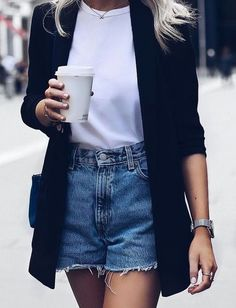 Classic black cardigan over white tee and denim shorts.