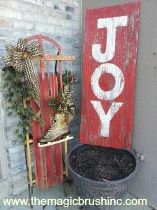 Gold Glittered Skates on Sled with Joy Wood Sign.