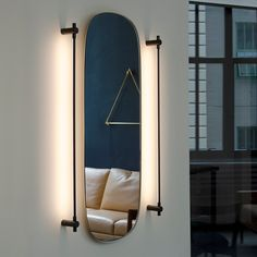 THIN Surface Mount Vanity Light by Juniper in our Brooklyn, New York showroom. Get inspired by linear lighting with minimal design. This Black Oxide resembles a luxurious Matte Black finish that will suit any bathroom vanity. Use this modern lighting design to illuminate contemporary double sinks or makeup vanity mirrors.