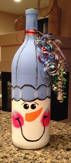 Snowman painted on a bottle of Wine- give with wine glasses or a wine decanter for a fabulous gift!