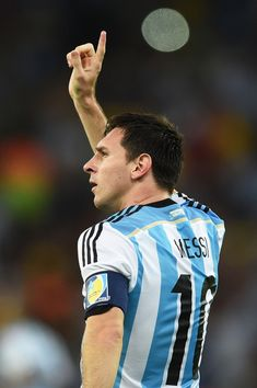 Lionel Messi Photos Photos - Lionel Messi of Argentina acknowledges the fans after defeating Bosnia Herzegovina 2-1 during the 2014 FIFA World Cup Brazil Group F match between Argentina and Bosnia-Herzegovina at Maracana on June 15, 2014 in Rio de Janeiro, Brazil. - Argentina v Bosnia-Herzegovina: Group F - 2014 FIFA World Cup Brazil