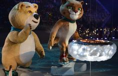 February 23, 2014 ~ the Sochi Olympic bear mascot blows and extinguishes the flame in the cauldron at the Closing Ceremony in Fisht Stadium and the Olympic flame just outside ~ one of the best I've seen and check out the children on the mascots feet.