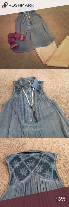 Adorable Free People Tunic Dusty blue Free People gauzy tunic with button placket and lace insert at shoulders/upper back. Adorable with white skinnies and sandals or dark jeans and booties! Free People Tops Tunics