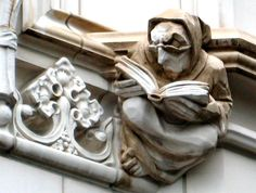 Here is a skeptical, grumpy figure from New York... it certainly makes you wonder, what he's reading?  gargoyle