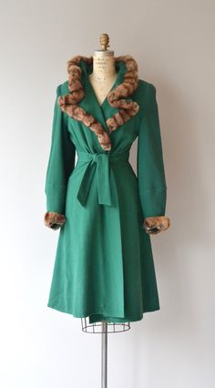 Vintage 1930s emerald green wool coat with dramatic formed fur collar and fur cuffs, subtle puff shoulders, tie on inside of the coat at the waist,