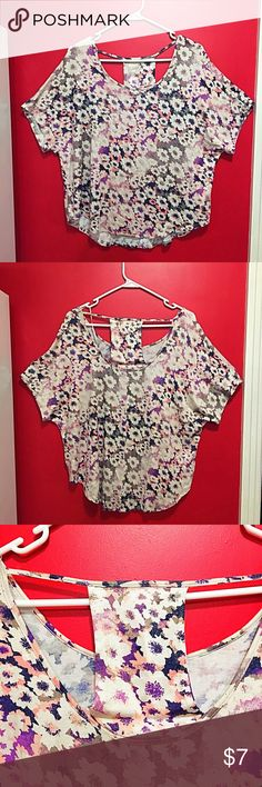 Juicy Couture Shirt  NWOT  Funky and cool floral Juicy Couture Shirt! Made of 95% Rayon and 5% Spandex, the shirt is super comfy and lightweight. It has a shimmering effect and a sexy back. Juicy Couture Tops Blouses