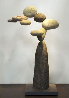 "^The art of sculptor Woods Davy is both inspired by nature and composed of natural elements. The artist, who lives and works in Venice, California, creates what he calls a sense of ""Western Zen"" with his gravity-defying rock sculptures. His Cantamar and Granite series feature a number of collected stones arranged in an impossible balancing act, leaving one to reflect on its unnatural configuration and one's own spirituality."