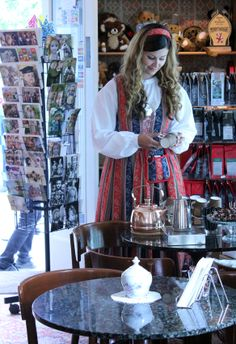"""Finnish traditional Coffee Company Paulig's pr person """"Paula-tyttö"""" (Paula girl) visited our customers in summer 2013. Paula is wearing finnish national costume and serves coffee from old-fashioned copperpot to everybody. Café Samovarbar, Suomenlinna, Helsinki, Finland. #paulig #paulatyttö"""