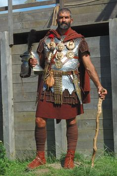 """Centurion with """"vitis"""". The vitis (vine stick) was a symbol of the centurion's authority and the implement with which he would mete out punishment."""