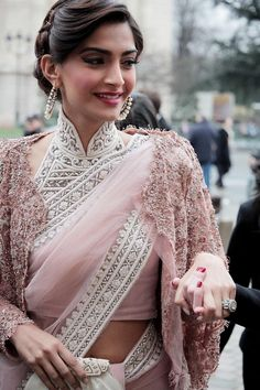 Sonam Kapoor in elegant buttoned up high neck embellished Saree blouse. Sonam Kapoor looks absolutely stunning in this simple saree with gorgeous blouse Saris, Bollywood Celebrities, Bollywood Fashion, Bollywood Saree, Bollywood News, Bollywood Actress, Indian Attire, Indian Wear, India Fashion